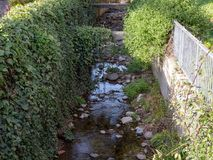 Man made creek on sunny day stock images