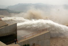 A man-made dam outlet flood peak Stock Images
