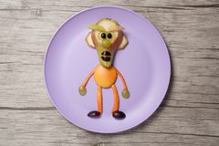 Man made with fruits on plate and wooden background Stock Image