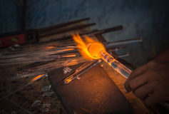 Man made hand craft from glass blowing with fire blower. Selective focus Royalty Free Stock Image
