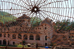 Man made rope spiders web. Museum seen through a man made rope cobweb Royalty Free Stock Photo