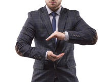 Man made a shape of a ball from his hands. Man in a suit made a shape of a ball from his hands and looking in camera Royalty Free Stock Photos