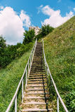 Man-made staircase upstairs to the hill with green grass, travel and tourism concept, vertical. Man-made staircase upstairs to the hill with green grass, travel Royalty Free Stock Photography