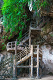 Man made stairs into cave on rocky cliff stock image
