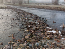 Man made stone dam Stock Photos