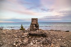 A man made structure on the beach in Flowerpot Island in Ontario. A man made structure beside the trail at sunset on Flowerpot Island in Ontario, Canada stock photo