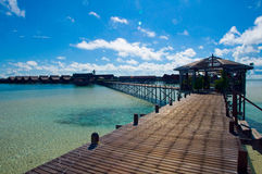 A man-made walkway Kapalai island. With exotic tropical resort Royalty Free Stock Photography