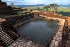 The man made water tank chisled out of solid rock which sits at the summit of Sigiriya Rock Fortress in Sri Lanka. It belonged to the royal city of King stock photos