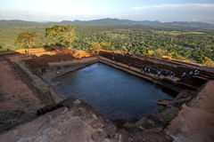 The man made water tank chisled out of solid rock which sits at the summit of Sigiriya Rock Fortress in Sri Lanka. It was constructed during the reign of King royalty free stock image