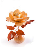Man-made wooden rose. On the white Stock Photo