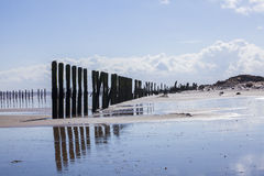 Man made wooden structures Spurn Point UK. Man made wooden structures on Spurn Point beach, lonliness and isolation, Yorkshire, UK stock photos