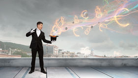 Man magician with cylinder hat Stock Image