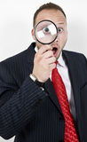 Man with magnified eyes Royalty Free Stock Images