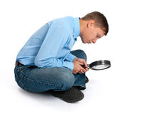 Man with magnifier Stock Photography