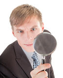 Man and magnifier. Portrait of business man  with magnifier in hand Stock Image