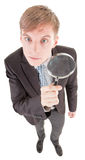 Man and magnifier Royalty Free Stock Photos