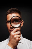 Man with magnifier Royalty Free Stock Image
