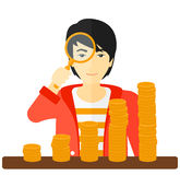 Man with magnifier and golden coins. An asian man holding a magnifier and looking at stacks of golden coins vector flat design illustration isolated on white Stock Photos