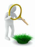 Man with magnifier and grass Stock Images