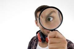 Man magnifing his eye Royalty Free Stock Photo