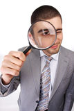 Man with magnifying glass. Portrait of a young business man with magnifying glass Stock Image