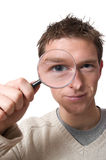 Man with magnifying glass Stock Photos