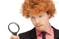 Man with magnifying glass Royalty Free Stock Photo