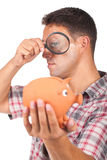 Man with a magnifying glass Royalty Free Stock Image