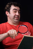 The man and magnifying glass Royalty Free Stock Photo