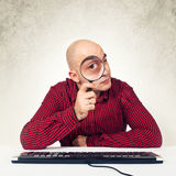 Man with magnifying glass Royalty Free Stock Image
