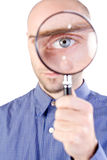 Man with magnifying glass Royalty Free Stock Photos