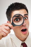 Man with magnifying glass Royalty Free Stock Photography