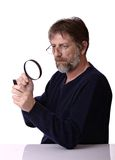 Man with the magnifying glass in hand Stock Photography