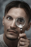 Man with magnifying glass Stock Image