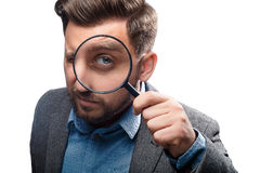 Man with magnifying glass on white background Stock Photos