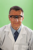 Man with Magnifying Glasses Stock Photography