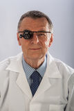 Man with Magnifying Glasses Royalty Free Stock Photography