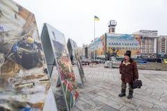 The man on the Maidan. Kiev. A man on Maidan examines photos. Kiev Royalty Free Stock Photography