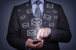 Man Mail Sending with Smartphone. On working business concept Stock Photography