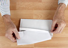 Man mailing letter in white envelope. Could be a job application or a resignation letter. Standard white business envelope Royalty Free Stock Photos