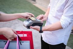 Man make payment with credit card swipe through terminal. custom. Er paying & entering code with EDC or swiping machine. buy and sell product or service Royalty Free Stock Images