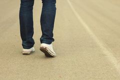 Man make step forward. In dirty shoes stock images