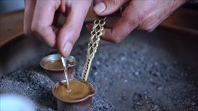 A man make Turkish coffee. Close view stock video footage