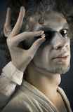 Man in make-up Stock Images