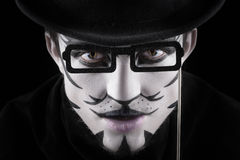 Man in make-up, looks like a cat. Royalty Free Stock Image