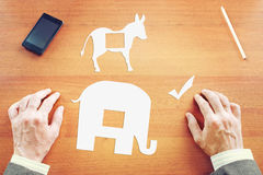 Man makes a choice between Democrats and Republicans. Conceptual image with paper scrapbooking Stock Image