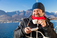 Man makes a coffee break on sailboat Royalty Free Stock Photo