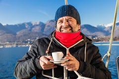 Man makes a coffee break on sailboat Royalty Free Stock Photos