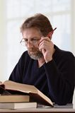 Man makes an entry in the notebook Stock Photos