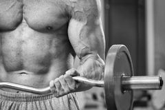 Man makes exercises with barbell Royalty Free Stock Photography